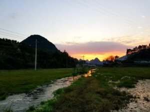Beautiful sunset during china trip over yangshuo's rice field